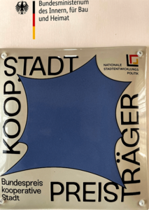 Plakette KOOP STADT (Foto)